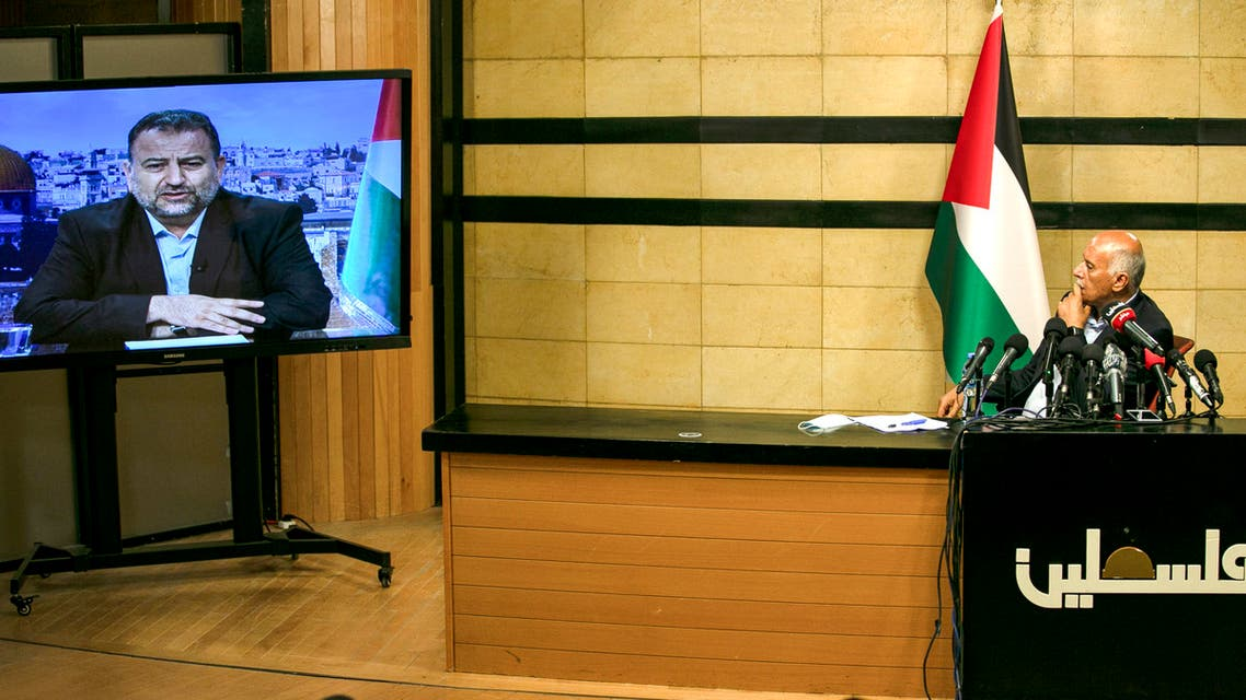 Senior Fatah official Jibril Rajoub, in the West Bank city of Ramallah, attends by video conference a meeting with deputy Hamas chief Saleh Arouri (on screen from Beirut) discussing Israel's plan to annex parts of the Israeli-occupied West Bank, on July 2, 2020.