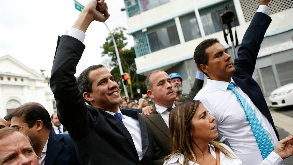 Opposition leader Juan Guaido leaves the National Assembly after initially blocked by National Guard from entering, in Caracas, Venezuela on Jan. 7, 2020. (AFP)