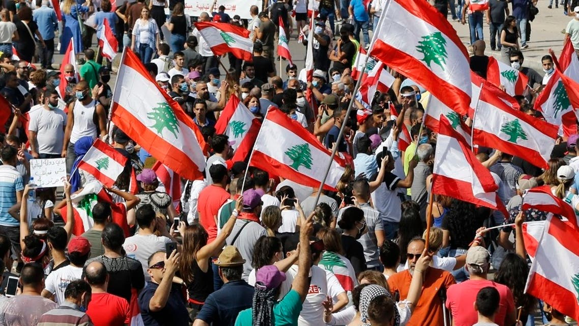 Anti-government protesters hold Lebanese national flags as shout slogans during a protest in downtown Beirut, June 6, 2020. (File Photo: AP)