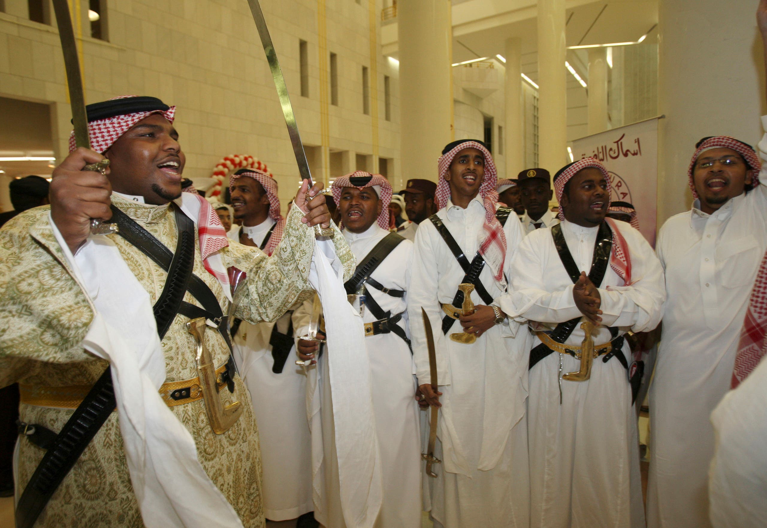 People sing celebration songs during a mass wedding ceremony in Riyadh, Saudi Arabia, June 24, 2008. (File photo: Reuters)