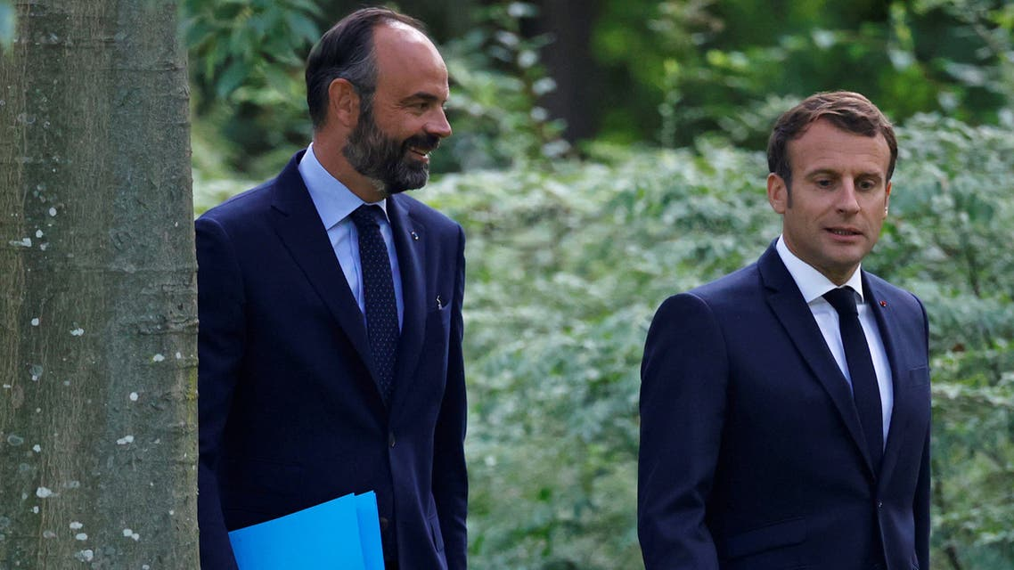 French President Emmanuel Macron and French Prime Minister Edouard Philippe arrive for a meeting with members of the Citizens' Convention on Climate (CCC) to discuss over environment proposals at the Elysee Palace in Paris, France June 29, 2020. REUTERS/Christian Hartmann/Pool