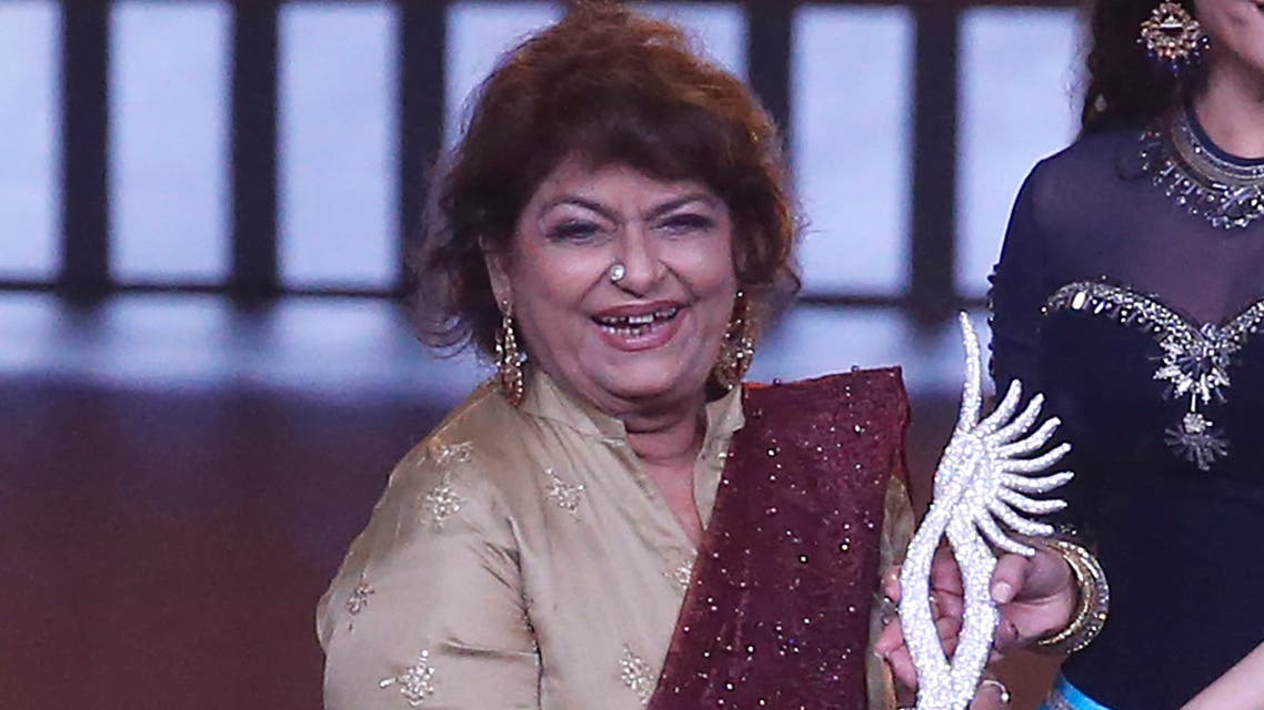 Indian choreographer Saroj Khan is presented a special award during the 20th International Indian Film Academy (IIFA) awards ceremony in Mumbai. (AP)