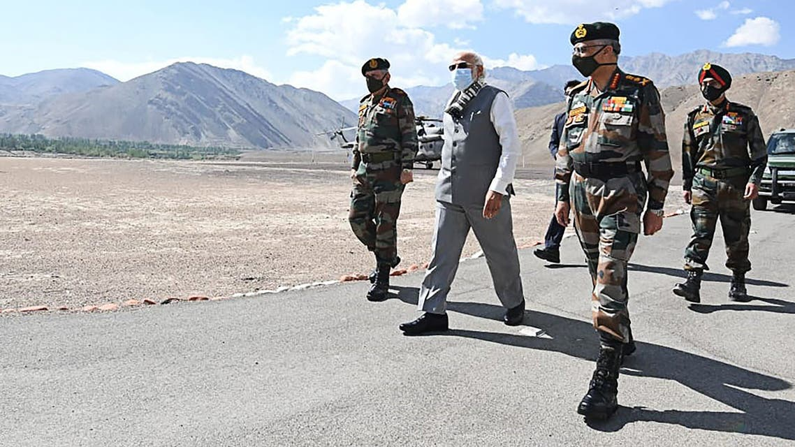 Indian Press Information Bureau (PIB), India's Prime Minister Narendra Modi (C) walks with military commanders as he arrives in Leh, the joint capital of the union territory of Ladakh. (AFP)