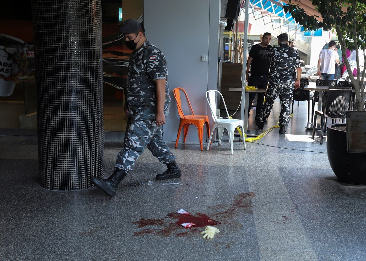 A Lebanese internal security member walks past bloodstains at the site where a man committed suicide in Beirut, Lebanon. (Reuters)