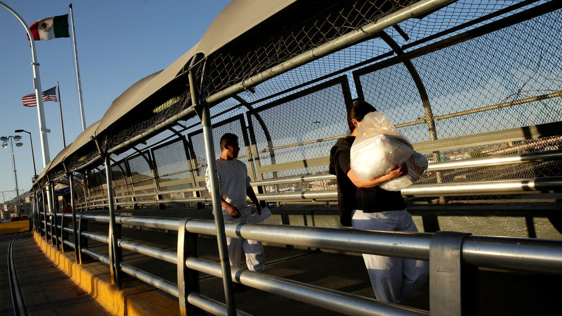 Mexican immigrants walk across the Paso del Norte border bridge after being deported from the United States amid the spread of the coronavirus disease (COVID-19), in Ciudad Juarez, Mexico April 29, 2020. (Reuters)