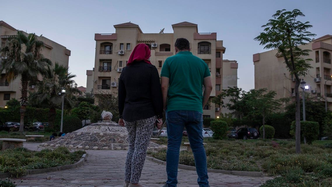 Noha, an Egyptian engineer, and her husband Ahmed, near their home in Cairo, June 30, 2020. (AP)