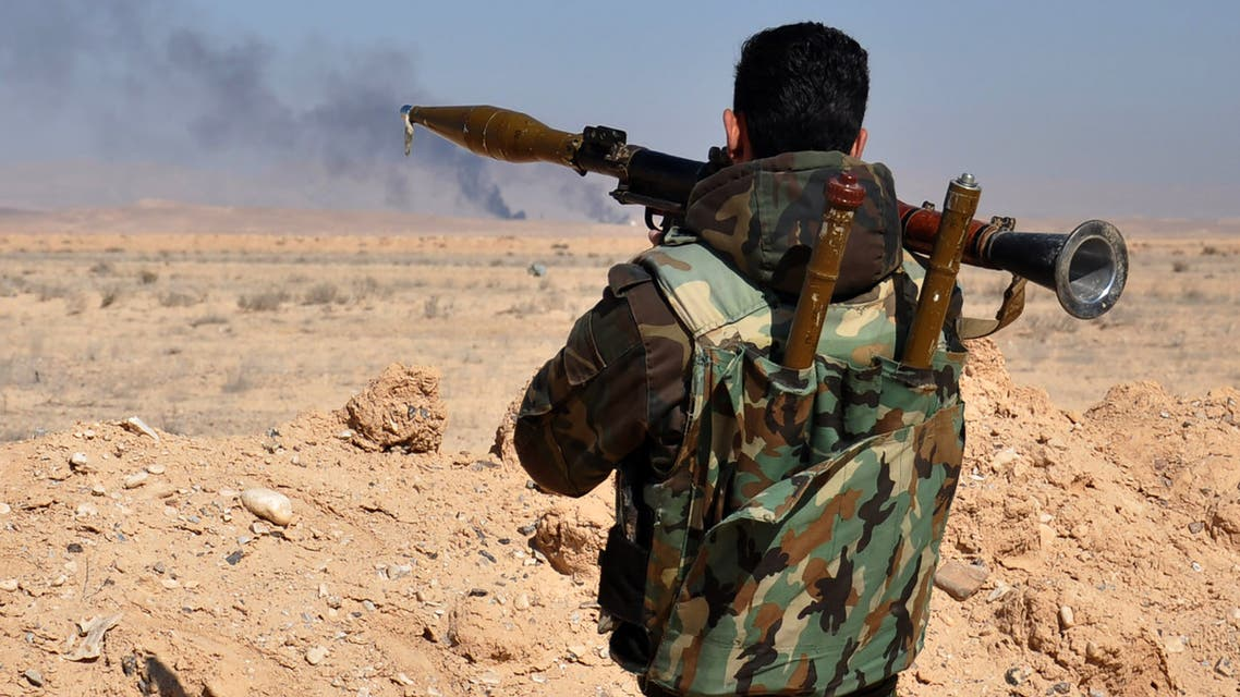 A Syrian regime fighter takes aim as they advance towards Hayyan oil field, east of the central Syrian Homs province on February 7, 2017. Regime troops had captured the Hayyan oilfield west of the celebrated desert city of Palmyra.