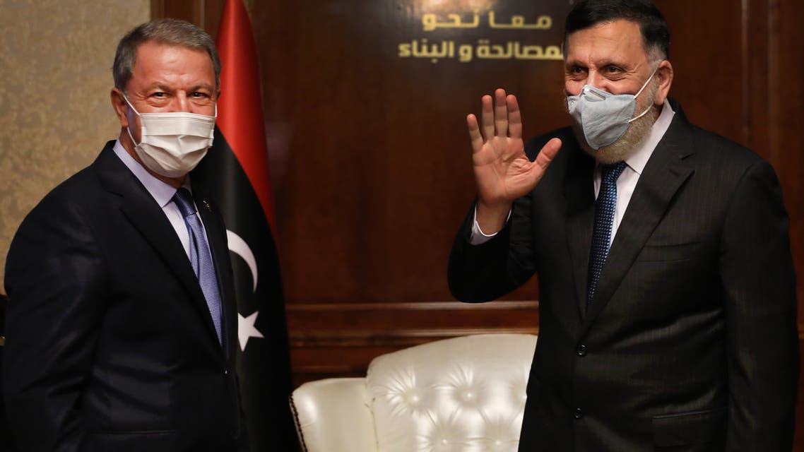 Fayez al-Sarraj (R), Prime Minister of Libya's UN-recognised Government of National Accord (GNA) receives Turkish Defense Minister Hulusi Akar (L), in the Libyan capital Tripoli on July 3, 2020.