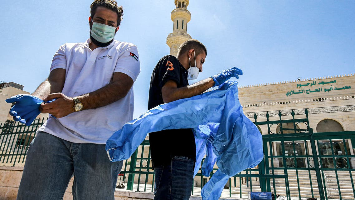 Workers suit up in PPE (personal protective equipment) before sterilising a mosque in Jordan's capital Amman on June 3, 2020, ahead of its re-opening. After more than 75 days of a lockdown for the COVID-19 coronavirus pandemic, Jordan decided to reopen mosques and churches in the kingdom starting from June 6.