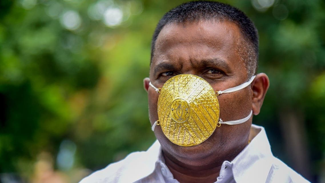 Businessman Shankar Kurhade wears a facemask made of gold and being worth 289,000 rupees amid concerns over the COVID-19 coronavirus outbreak, in Pune on July 4, 2020. (AFP)