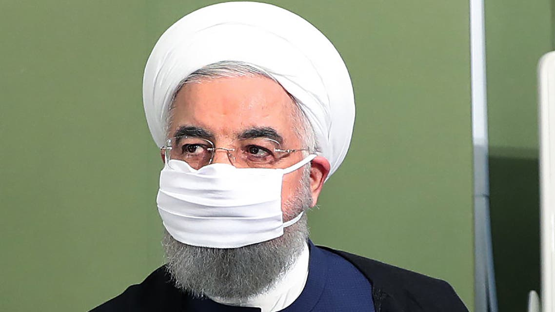 A handout picture made available by the Iranian presidency on July 4, 2020, shows Iran's President Hassan Rouhani wearing a face mask as he attends a cabinet session in the capital Tehran.