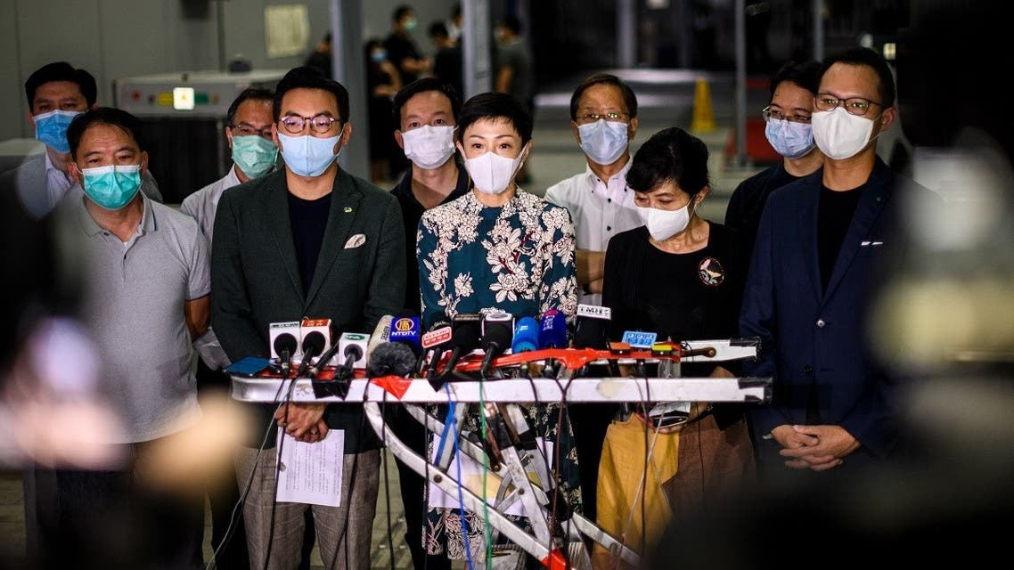 Tanya Chan (C) of the Civic Party and other pro-democracy lawmakers gather outside the entrance of the Legislative Council for a press conference in Hong Kong late on May 21, 2020. (AFP)