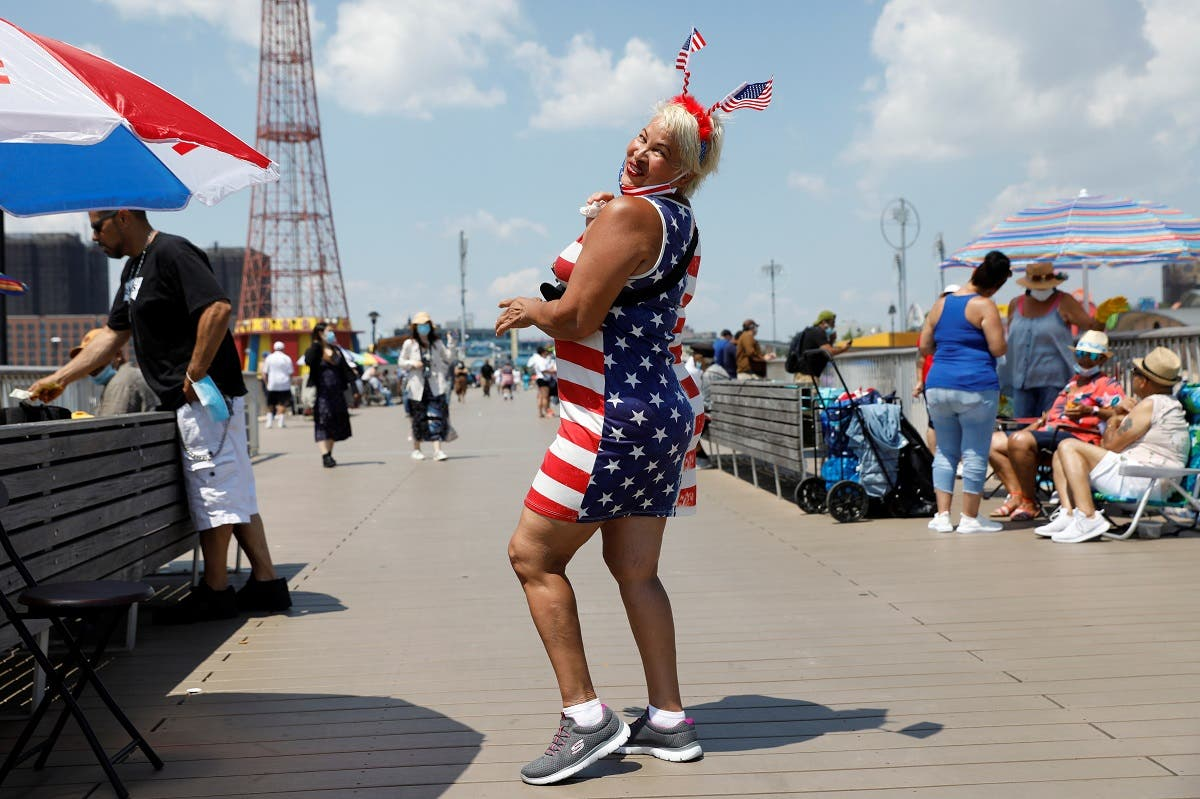 A beachgoer dances on the pier at Coney Island on the Fourth of July holiday in Brooklyn, New York City. (Reuters)