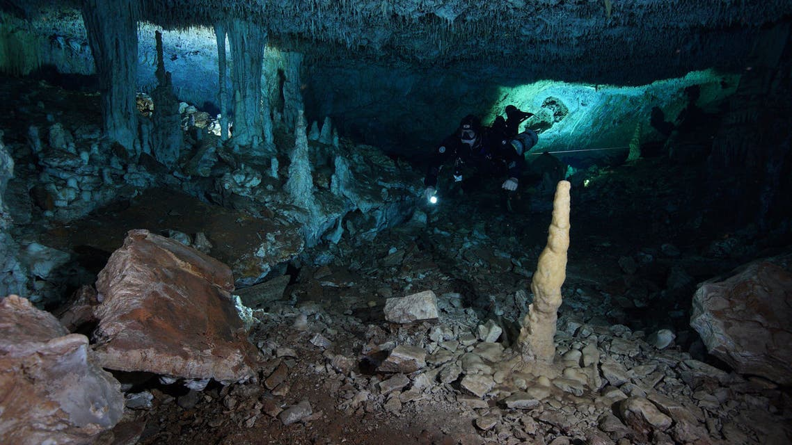 A diver from Centro Investigador del Sistema Acuifero de Q Roo (CINDAQ A.C.) is pictured in an ochre mine found in a cave that is now underwater in Mexico's Yucatan Peninsula, in this undated picture obtained by Reuters on July 2, 2020. CINDAQ.ORG/Handout via REUTERS THIS IMAGE HAS BEEN SUPPLIED BY A THIRD PARTY. NO RESALES. NO ARCHIVES