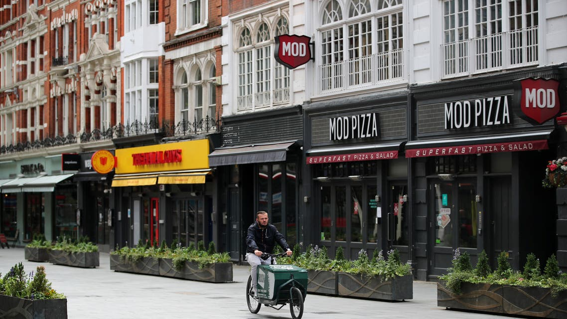 A person cycles past closed restaurants in Leicester Square, amid the spread of the coronavirus disease (COVID-19), in London, Britain June 17, 2020. (Reuters)