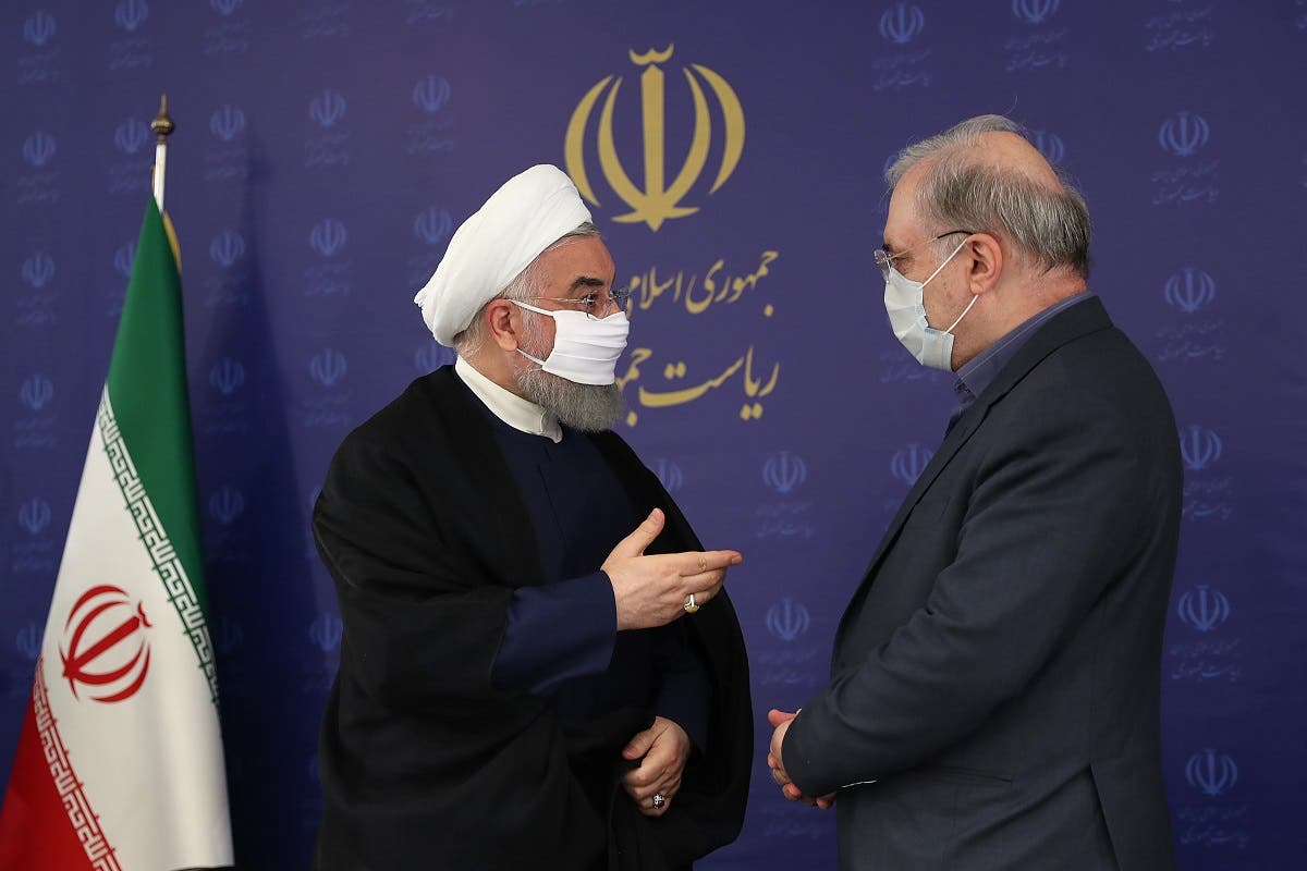 Iran's President Hassan Rouhani (L), and Minister of Health Saeed Namaki, wearing face masks as they attend a cabinet session in the capital Tehran. (AFP)