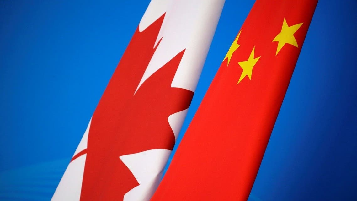 Flags of Canada and China are placed for the first China-Canada economic and financial strategy dialogue in Beijing, China, November 12, 2018. REUTERS