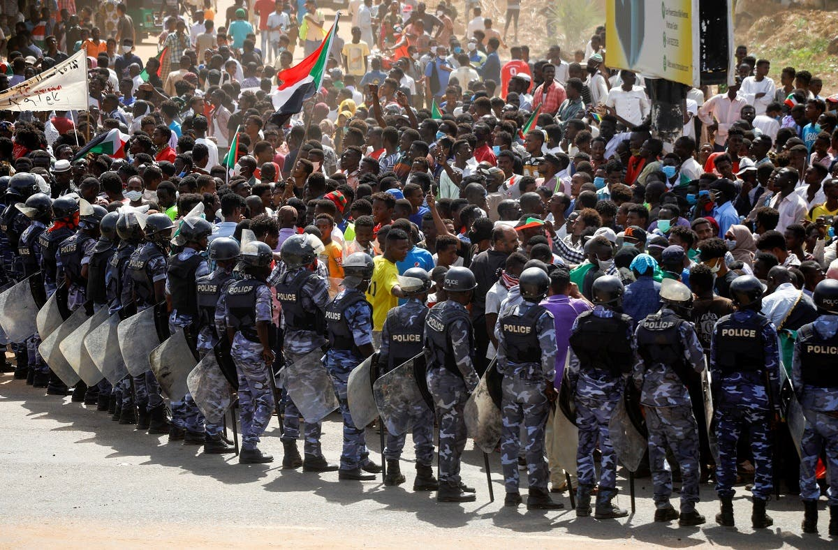 Riot police officers hold position against protesters near the Parliament buildings in Omdurman, Khartoum, Sudan June 30, 2020. (Reuters)