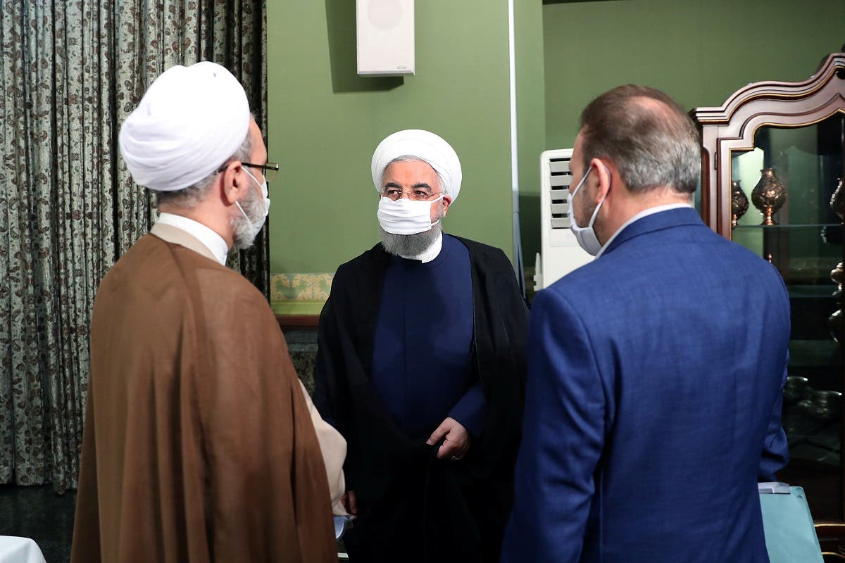 Iranian President Hassan Rouhani is seen wearing a face mask during a meeting, in Tehran. (Reuters)