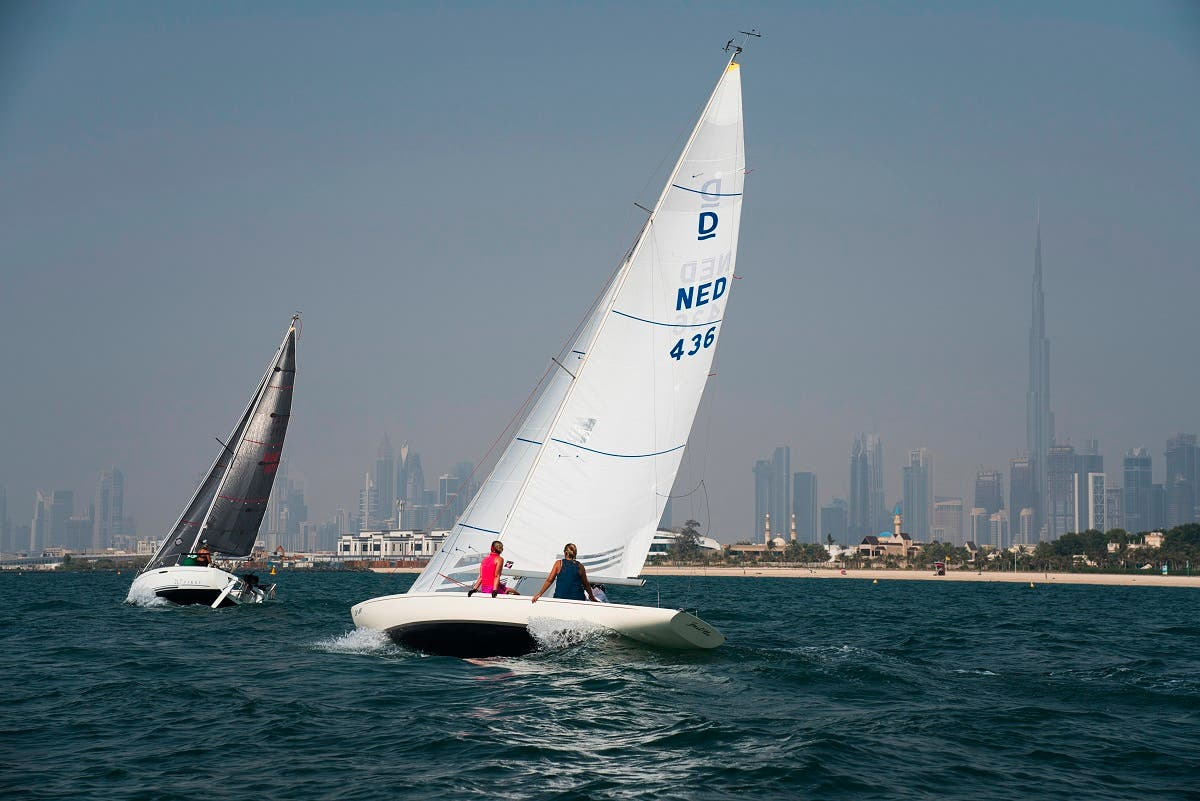 Sailboats taking part in a race catch the wind with the Burj Khalifa, the world's tallest building, seen in the distance in Dubai, United Arab Emirates, Friday, June 19, 2020. (AP)