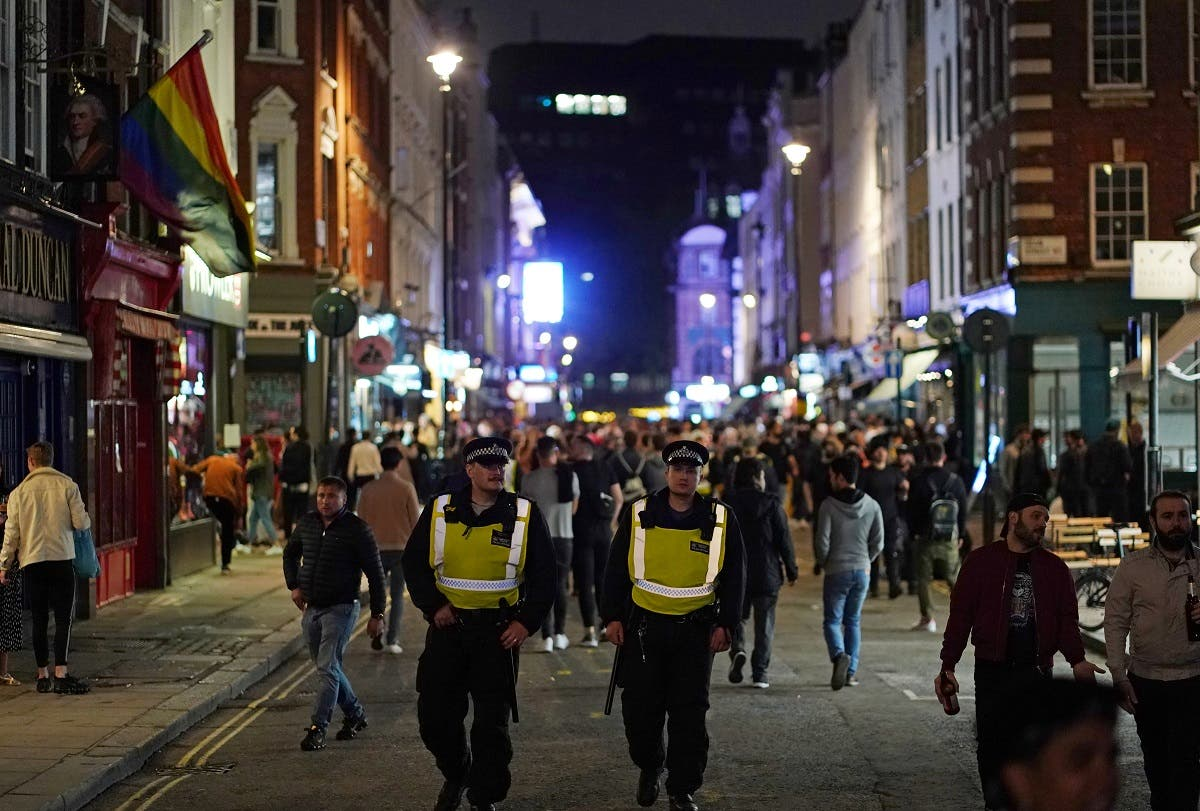 Police on patrol as people gather in Soho, as restrictions are eased following the outbreak of the coronavirus disease (COVID-19), in London, Britain. (Reuters)