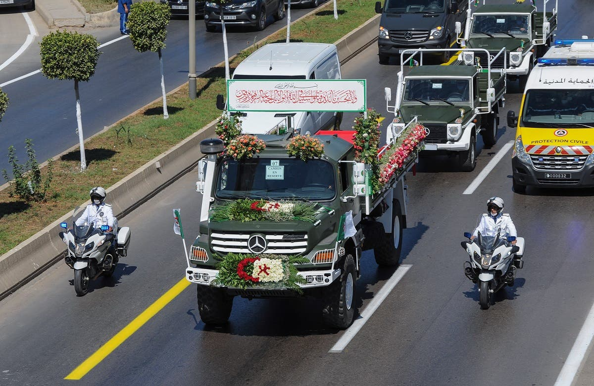 A convoy of coffins draped with the national flag heads towards their final resting place at El Alia cemetery in a suburb of the capital Algiers, on July 5, 2020. (AFP)