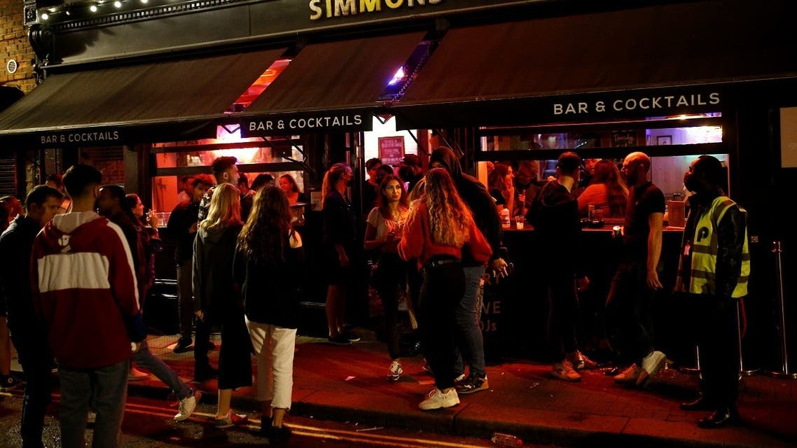 People gather in Soho, as restrictions are eased following the outbreak of the coronavirus disease (COVID-19), in London, Britain. (Reuters)