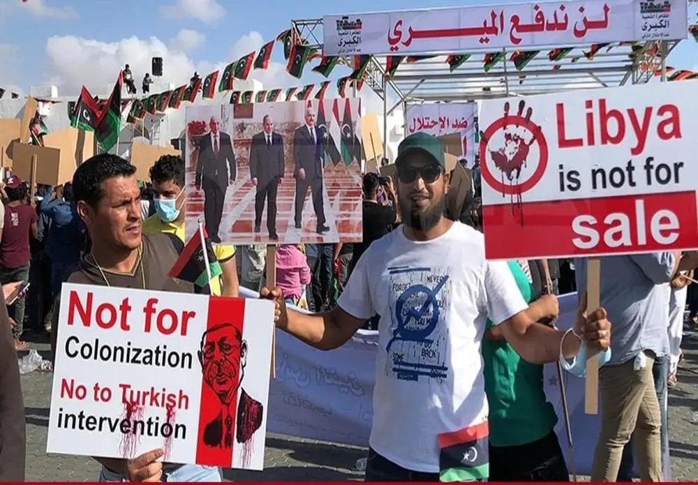 Libyan protesters holding signs saying Libya is not for colonization in Benghazi, June 5, 2020. (Al Arabiya)