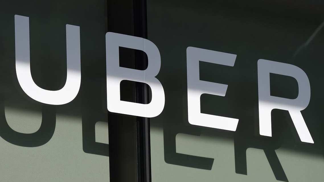 In this file photo the Uber logo is seen at the second annual Uber Elevate Summit, on May 8, 2018 at the Skirball Center in Los Angeles, California. (AFP)