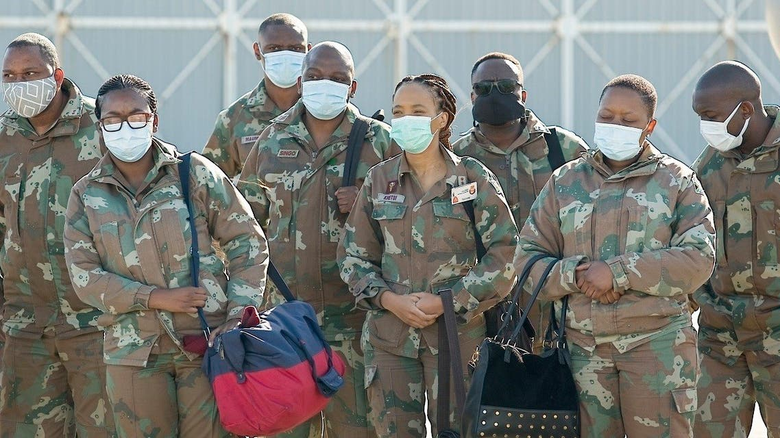 South African National Defense Force military health practitioners arrive at Air Force Station Port Elizabeth on the north-eastern side of the Port Elizabeth Airport, on July 5, 2020. (AFP)
