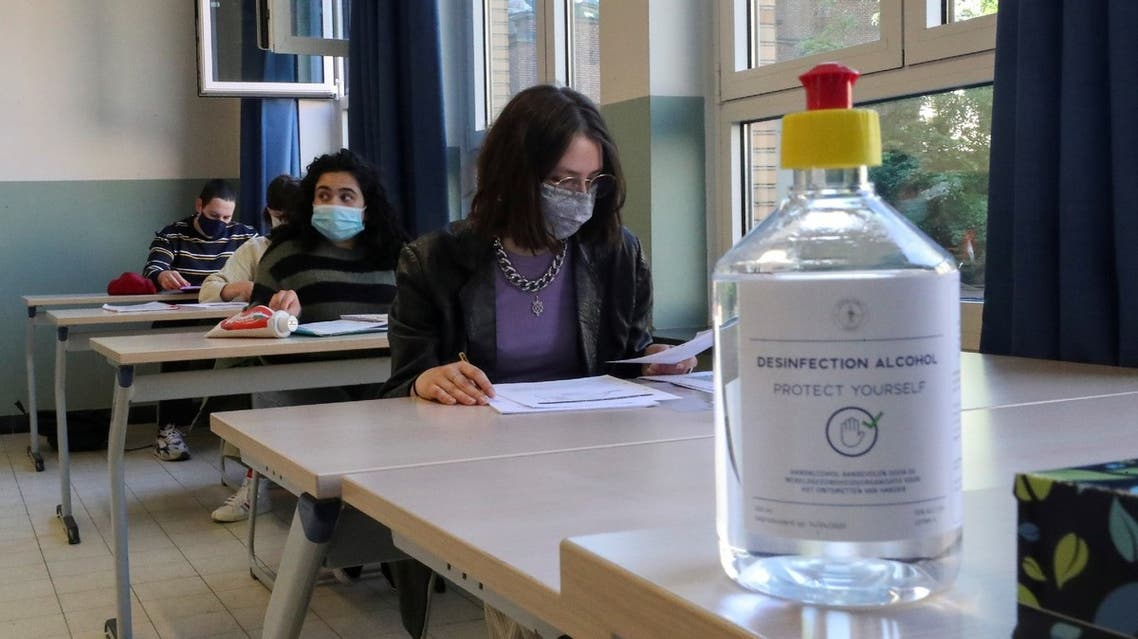Students wearing protective face masks are seen in a classroom in Brussels, Belgium, May 15, 2020. (Reuters)