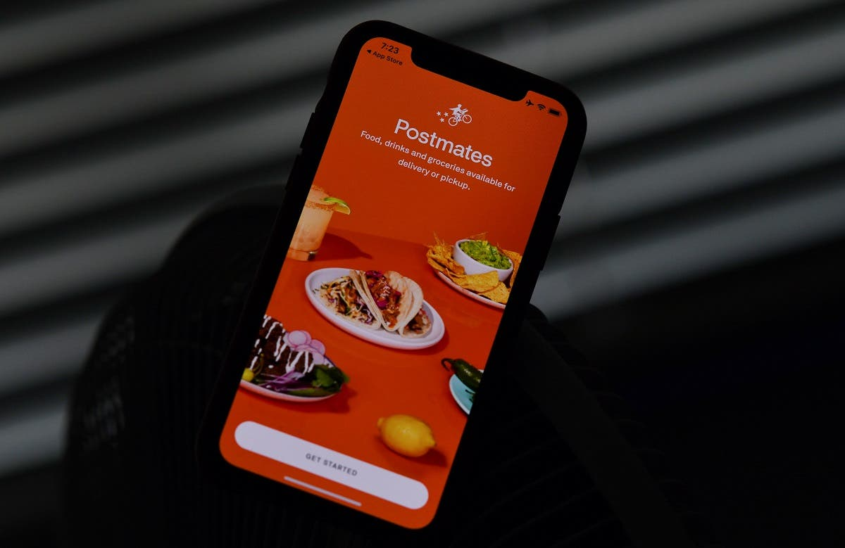 This file illustration photo taken on June 30, 2020 shows the logo of delivery app Postmates on a smartphone screen in Los Angeles. (AFP)