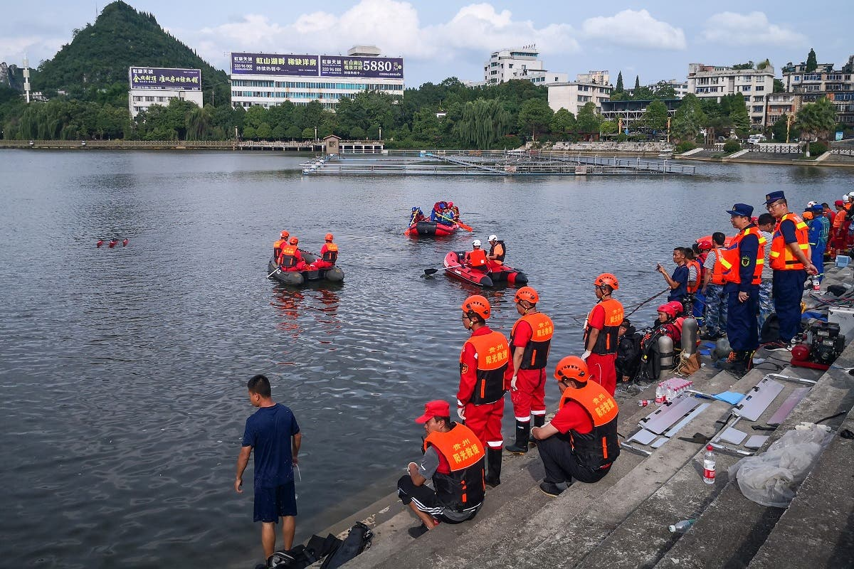 Rescuers search for survivors after a bus plunged into a lake in Anshun in China's southwestern Guizhou province on July 7, 2020. (AFP)