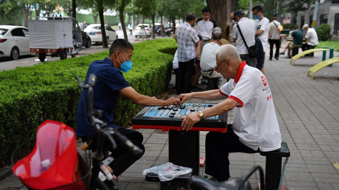Men play Chinese chess in a park in Beijing on July 3, 2020. (AFP)