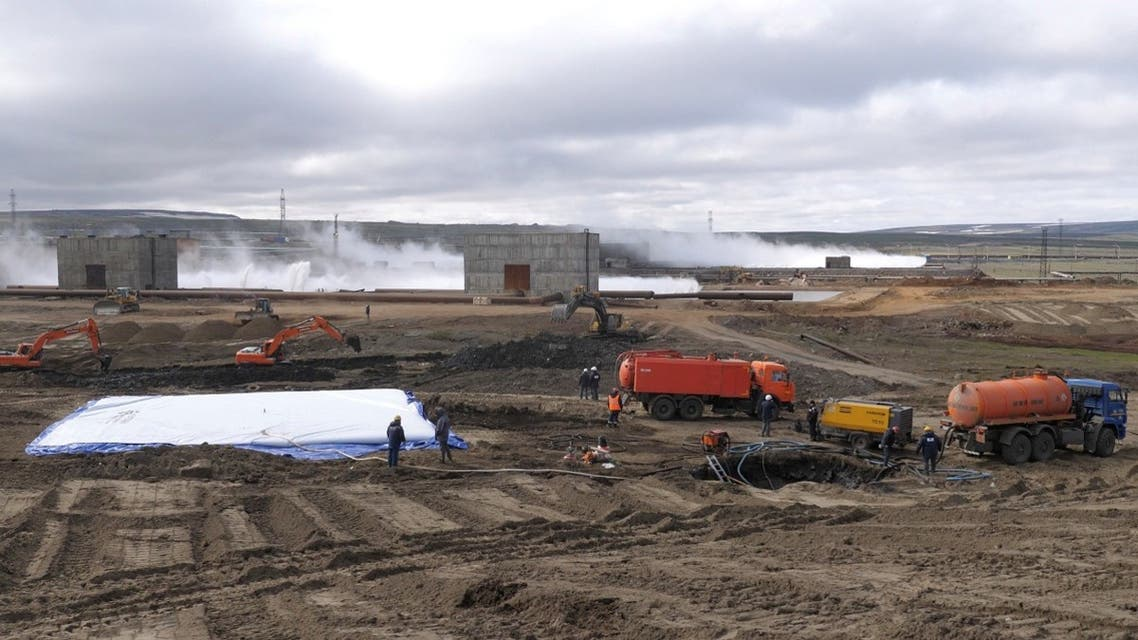 Specialists take part in recovery works following a diesel fuel leak at a thermal power station outside Norilsk in Krasnoyarsk Region, Russia in this handout picture released June 6, 2020. (Reuters)