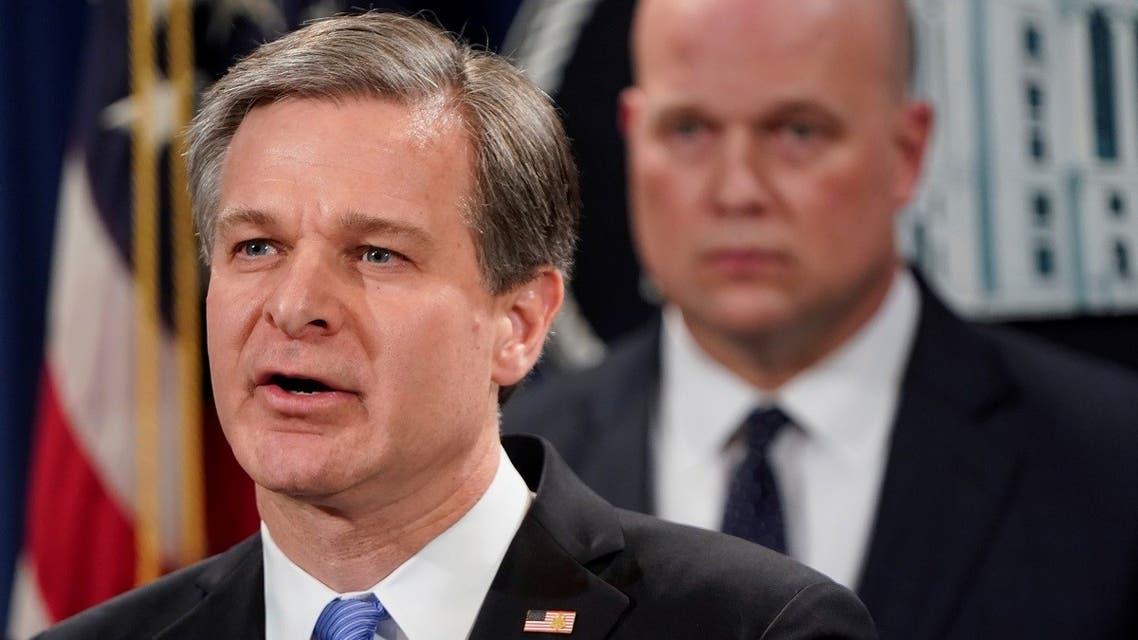 FBI Director Christopher Wray addresses a news conference with Acting U.S. Attorney General Matthew Whitaker to announce indictments against China's Huawei Technologies Co Ltd, several of its subsidiaries and its chief financial officer Meng Wanzhou, in a pair of cases accusing the company of everything from bank and wire fraud to obstructing justice and conspiring to steal trade secrets from T-Mobile US Inc., at the Justice Department in Washington, U.S., January 28, 2019. REUTERS/