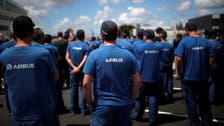 Thousands of Airbus workers march, stage 'empty chair' protest over job cuts