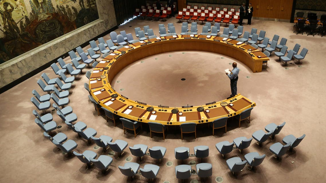 (FILES) In this file photo taken on September 20, 2017 an official looks at the empty chairs of leaders ahead of their participation in an open debate of the United Nations Security Council in New York. The UN Security Council on July 1, 2020 unanimously adopted a resolution calling for a halt to conflicts to facilitate the fight against the COVID-19 pandemic, after more than three months of painstaking negotiations, diplomats said.
