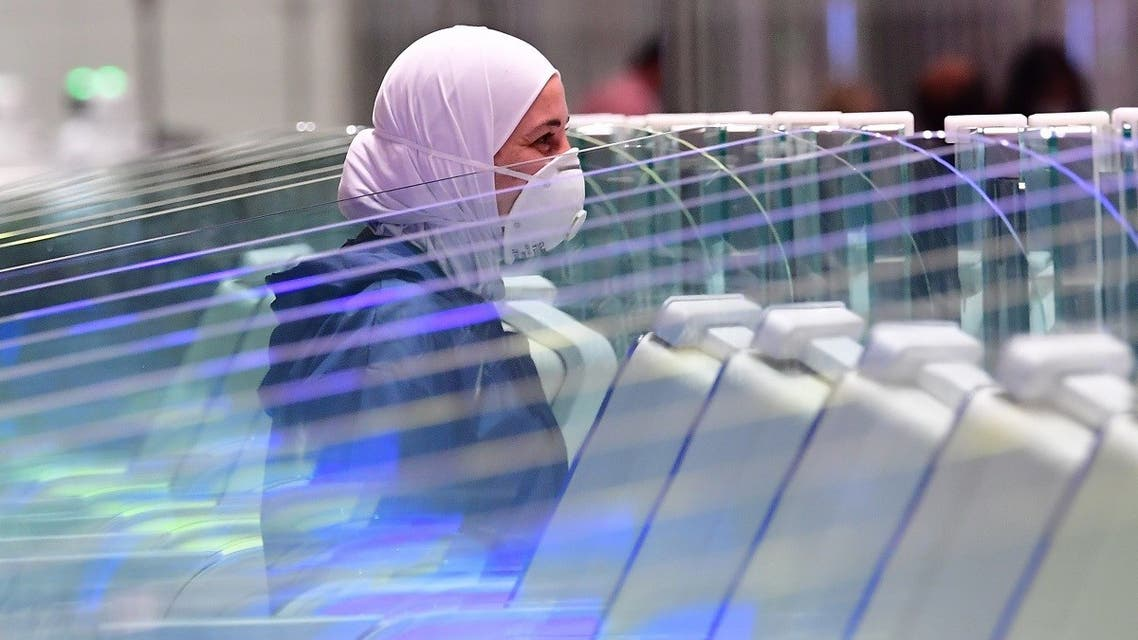 A tourist waits to have her papers checked upon arrival at Teminal 3 at Dubai airport, in the United Arab Emirates. (AFP)
