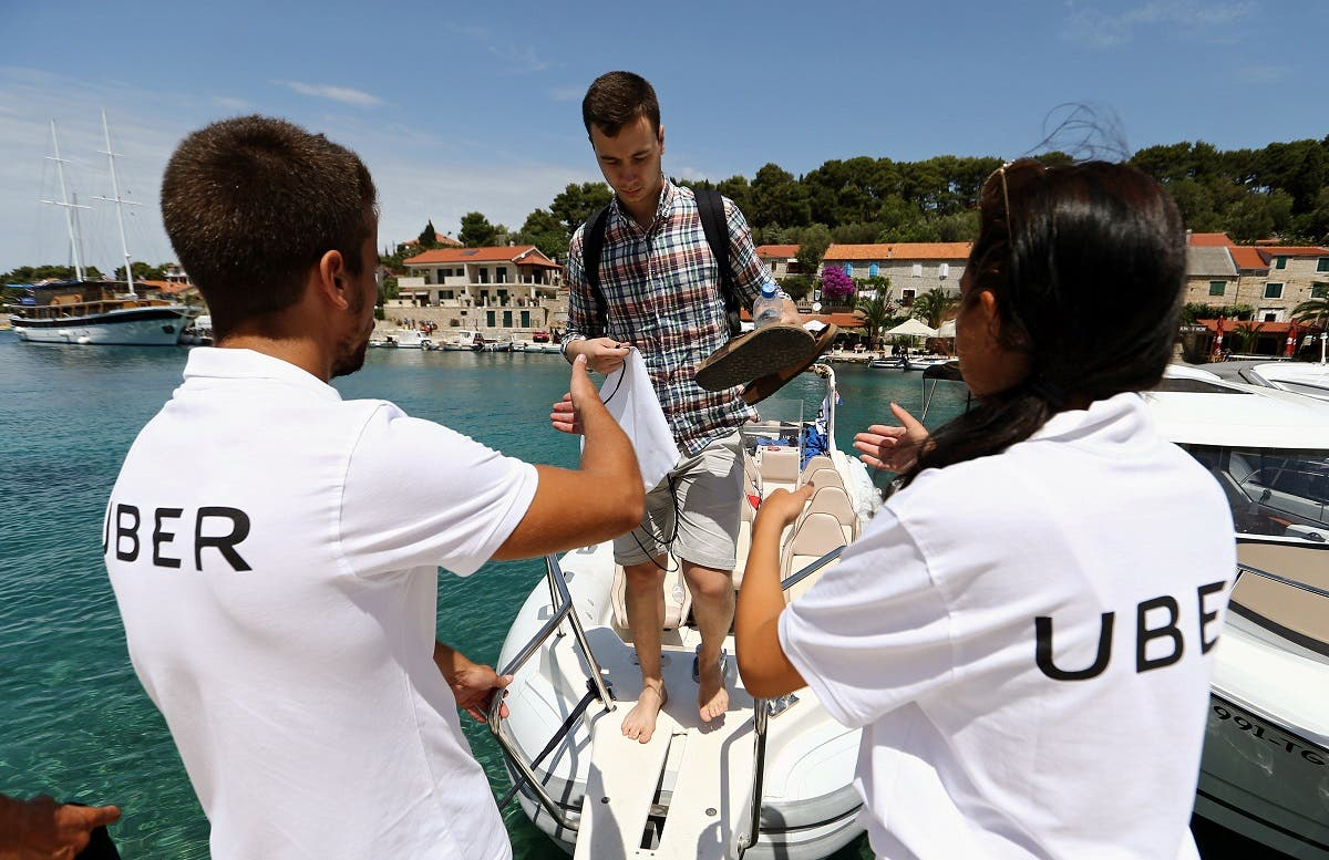 File photo of crew members from an Uber Boat helping a man exit the boat at the Adriatic sea on the island of Solta, Croatia. (Reuters)