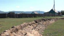 Coronavirus: Russia digs trench around Siberian village to enforce quarantine
