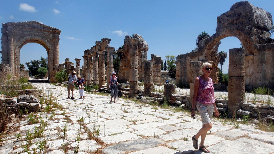 Tourists walk at the Roman ruins in Tyre, Southern Lebanon August 4, 2017. (Reuters)