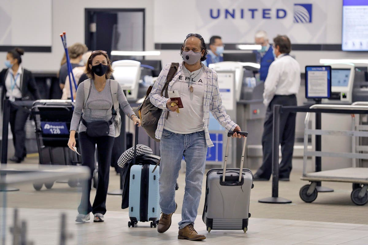 Passengers wearing personal protective face masks leave the United Airline ticket counter after checking on June 16, 2020, at the Tampa International Airport in Tampa, Fla. (AP)