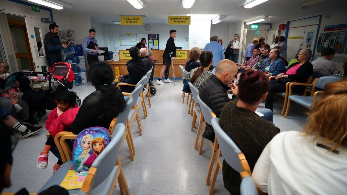 NHS patients in a waiting room at ilton Keynes University Hospital in Milton Keynes, UK, June 8, 2018. (Reuters)