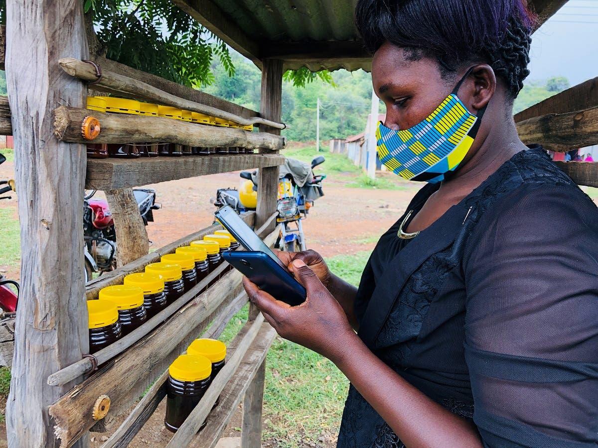 Dorcas Kipkeroi, a honey vendor uses her cell phone to test the Loon technology internet via video call in Radad, Baringo County, Kenya. (Reuters)