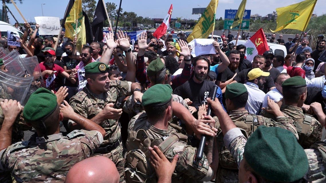Hezbollah supporters clash with the Lebanese army after they are forced to reopen a blocked road, July 8, 2020. (AP)