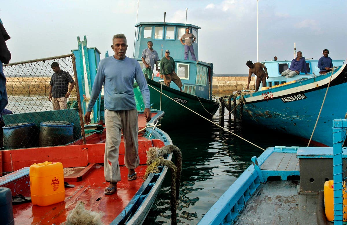 A boat crew member walks on his ship at a port which brings goods to and from the nations remote atolls in Male, the capital of the Maldives Wednesday Jan. 12, 2005. (AP)