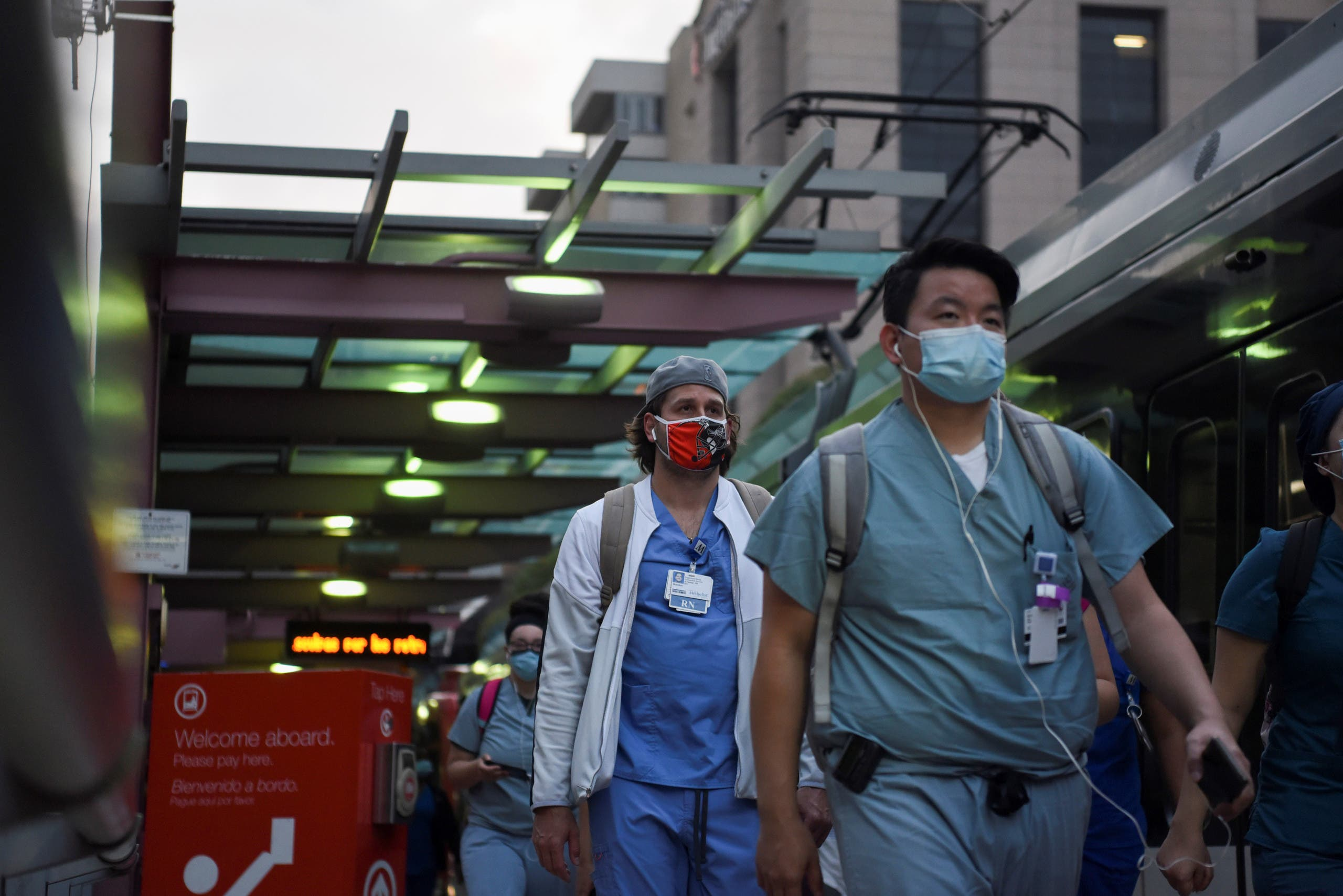 Healthcare workers walk through the Texas Medical Center as cases of the coronavirus spike in the United States, July 8, 2020. (Reuters)