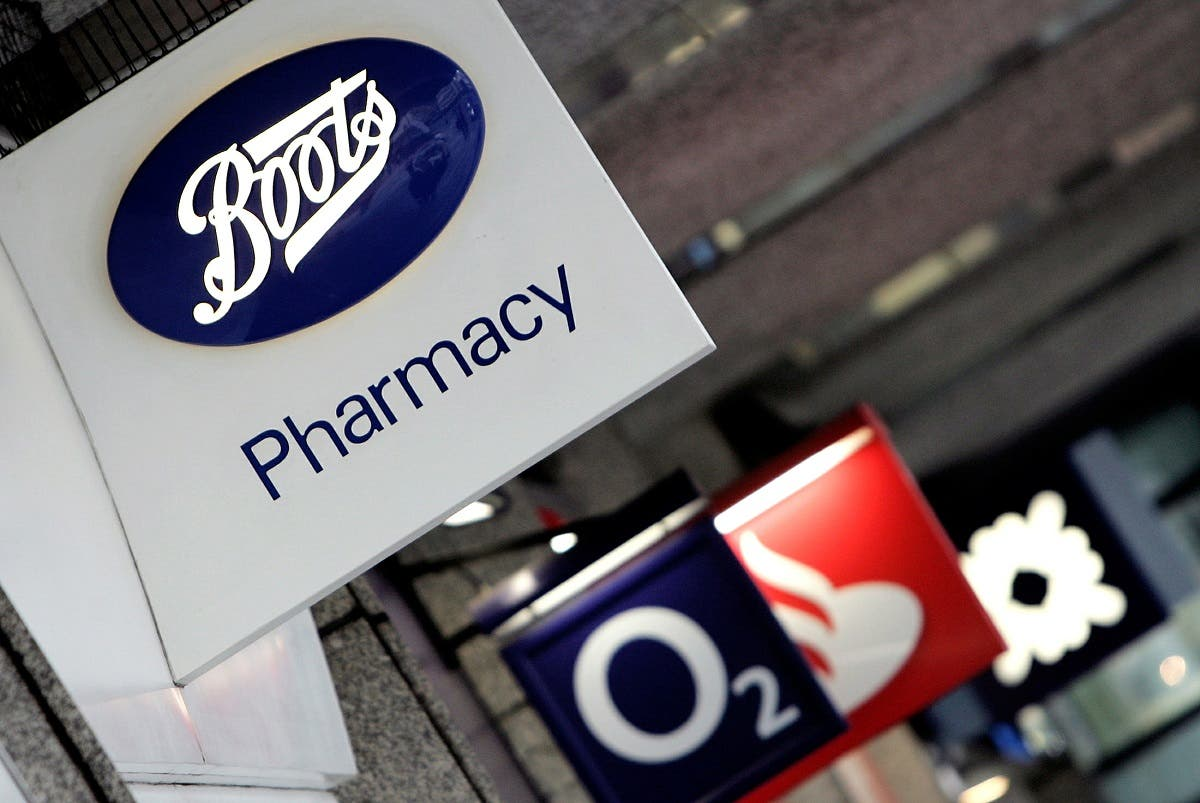 A logo of the British chemist chain, Boots, is seen in central London. (Reuters)