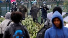 French police dismantle a shelter camp in Calais removing hundreds of migrants